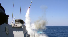 """In this photo obtained from the US Navy, the guided missile destroyer USS Porter  on March 22, 2003, launches a Tomahawk missile toward Iraq during the initial stages of shock and awe.  The US has launched 'dozens of Tomahawk cruise missiles' at Syrian air bases, according to US officials on April 6, 2017. The United States on Thursday threatened Syria with military action as President Donald Trump warned """"something should happen"""" following a suspected chemical attack that left at least 86 dead and provoked global outrage. / AFP PHOTO / CHINFO, Navy Visual News Service / HO / RESTRICTED TO EDITORIAL USE - MANDATORY CREDIT """"AFP PHOTO / US NAVY / Lt. Christopher Senenko"""" - NO MARKETING NO ADVERTISING CAMPAIGNS - DISTRIBUTED AS A SERVICE TO CLIENTS  HO/AFP/Getty Images"""